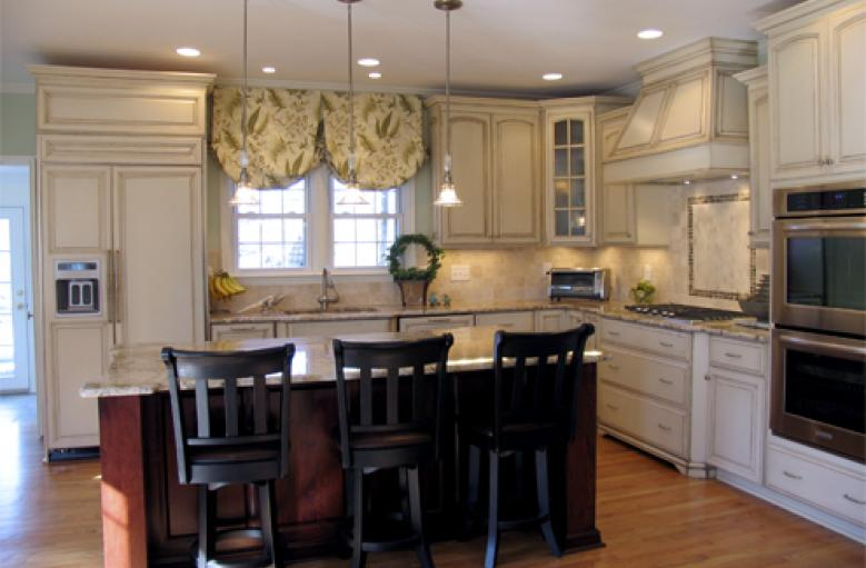 The Massive Cherry Wood Island Is Surrounded On Two Sides By Distressed  Antique White Maple Kitchen Cabinets