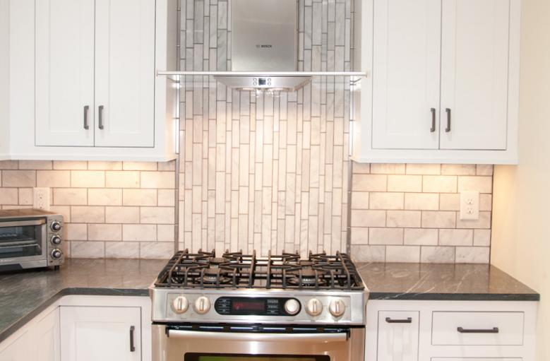 Stainless steel appliances, carrara backsplash, soapstone countertops
