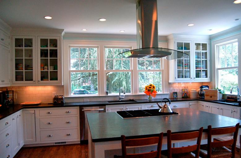 Soapstone Countertops Provide A Sleek Contrast To The White Cabinetry